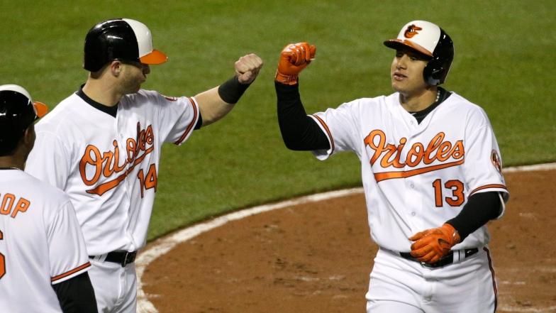 Nolan Reimold et Manny Machado