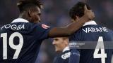 Paul Pogba et Raphaël Varane