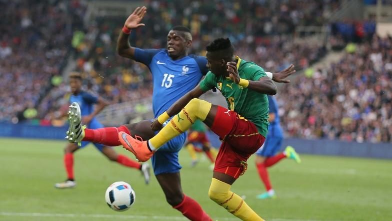 Ambroise Oyongo et Paul Pogba