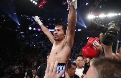 Manny Pacquiao négocie avec Amir Khan