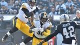 Les Steelers et les Raiders en plein action
